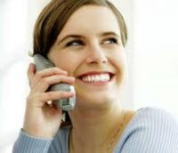 Smiling girl on the telephone providing Customer Service