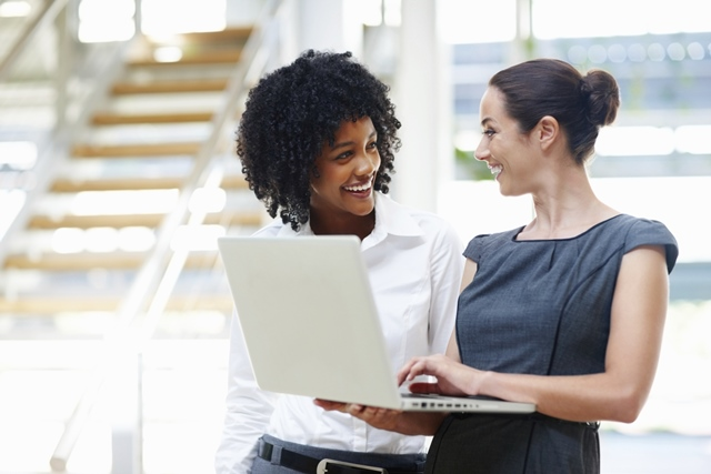Two business women using laptop
