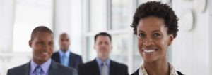 Smiling businesswoman with colleagues in meeting room