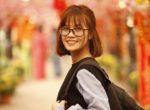 Smiling Studious Young Woman with Backpack_female