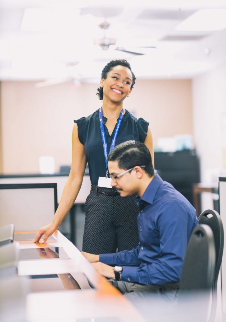Careersource Florida employee assisting a client